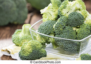 Portion of Raw Broccoli on dark wooden background