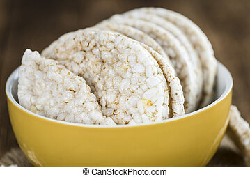 Rice Cakes - Portion of Rice Cakes (close-up shot) on wooden...