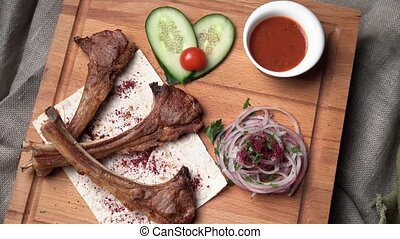 portion of roasted rib with onions and ketchup - portion of...