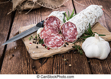Portion of Salami Slices with fresh Herbs and Garlic