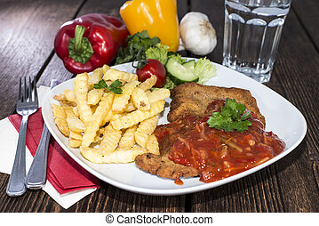 Portion of Schnitzel with Sauce - Portion of Schnitzel with...