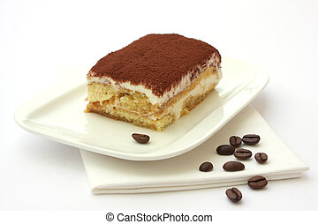 Portion of self-made tiramisu dessert served on a plate