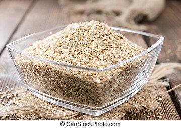 Portion of Sesame (detailed close-up shot) on wooden background