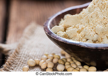 Portion of Soy Flour on dark rustic wooden background