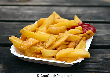 portion of takeaway chips in a white container