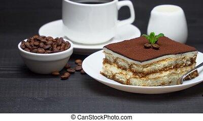 Portion of Traditional Italian Tiramisu dessert, cup of espresso, milk , brown sugar and coffee.