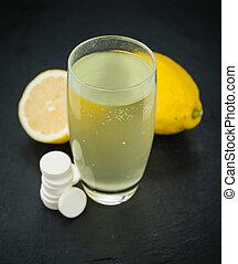Portion of Vitamin C Tablets on a slate slab
