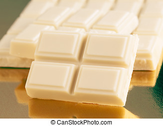 portion of white chocolate on gold base