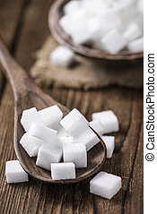 Portion of white Sugar (selective focus) on vintage wooden ...