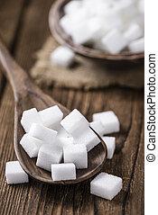 Portion of white Sugar (selective focus) on vintage wooden...
