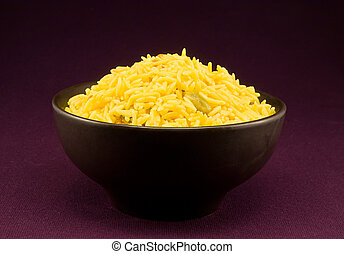 Bowl full of pilau rice a special gourmet indian side dish flavoured with spices from india including cumin, cardamom and bay leaves