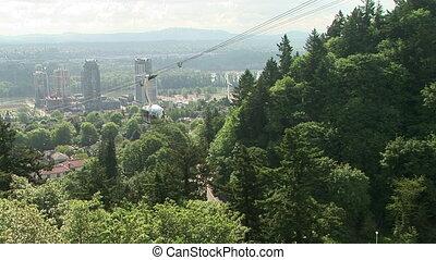 Portland Aerial Tram - Aerial tram going up a hillside in...