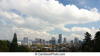 Portland Oregon Downtown City Skyline in Colorful Fall Autumn Season against Blue Sky and White Clouds Timelapse Ultra High Definition 4096x2160
