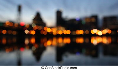 Portland Oregon Scenic View of Downtown City Skyline with Hawthorne Bridge across Willamette River Out of Focus Blurred Bokeh City Lights Beautiful Water Reflection at Blue Hour 1920x1080