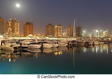 Porto Arabia at dusk. The Pearl in Doha, Qatar