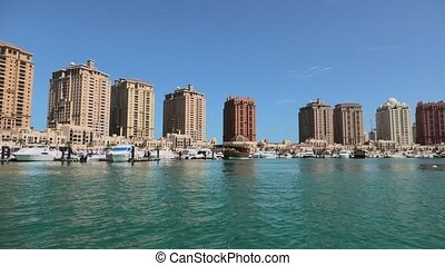 Porto Arabia Doha boats - Luxurious yachts and boats docked...