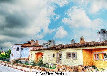 Porto Cervo buildings under a dramatic sky in hdr
