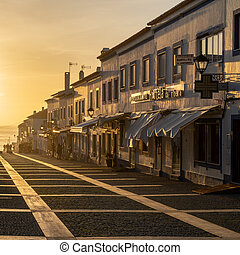 main street in Porto Covo at sunset