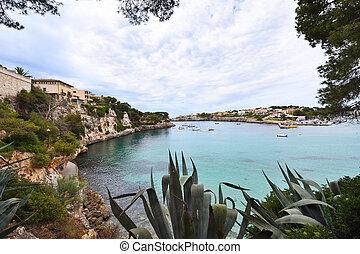Porto Cristo bay with boats on the island of Mallorca in Spain