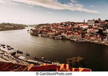 Porto, Portugal, amazing view of Riberia district with historical houses and Douro river seen from Ponte de Dom Luis bridge