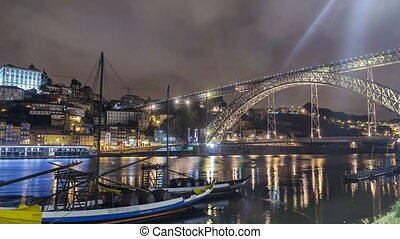 Porto, Portugal old town skyline on the Douro River with rabelo boats timelapse hyperlapse.