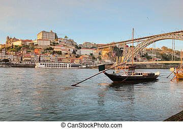 Porto, Portugal: sunset view of iconic Dom Luis bridge and...