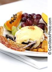 Portobello mushroom brie eggs benedict with bacon and fruits...