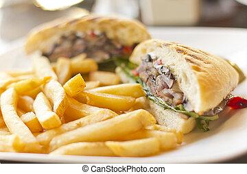 Portobello mushroom sandwich on a toasted ciabatta bun and side of fries