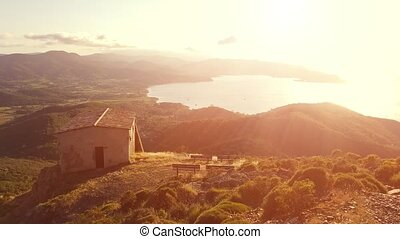 Panoramic sunset of Portoferraio Gulf, Elba Island, from mount Volterraio on which the fortress dominates north part of island of Tuscany Archipelago, Italy. Church of San Leonardo on background.