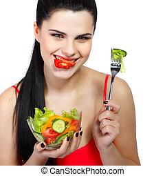 porträt, von, a, hübsch, junge frau, essende, gemüse, salat, freigestellt, auf, a, weißer hintergrund