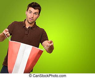 porträt, von, a, junger mann, besitz, einkaufstüte