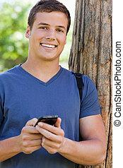 porträt, von, a, muscled, schueler, mit, a, smartphone