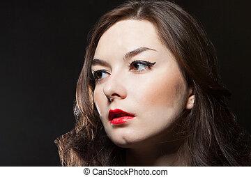 porträt, von, junge frau, auf, dunkler hintergrund
