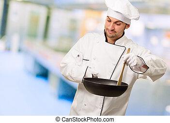 portræt, i, en, køkkenchef, tillave mad