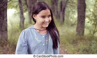 Portrait. A Little beautiful girl is walking and smiling beautifully
