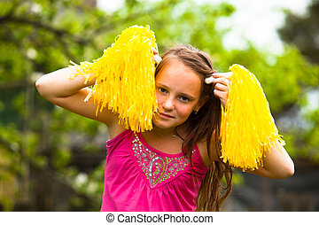 Portrait a lovely fun teen-girl in the garden