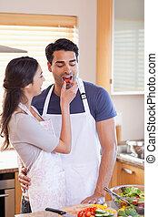 Portrait a woman feeding her husband