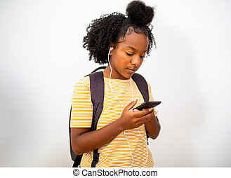 african american teenager girl listening to music with cellphone