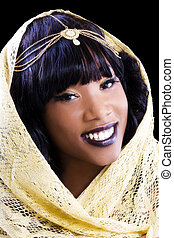 Portrait African American Woman Wrapped in Golden Shawl