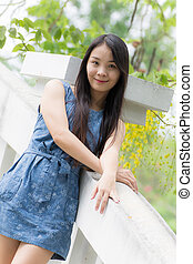 Portrait Asian woman at rail bridge