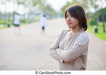 portrait asian woman in park.