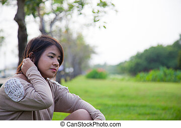 Portrait Asian woman sitting in the park.