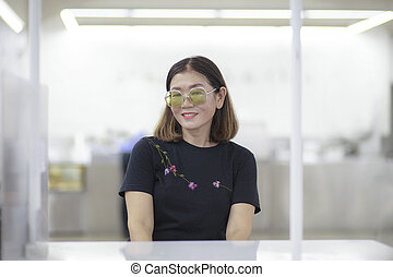 portrait asian woman toothy smiling face in white cafe