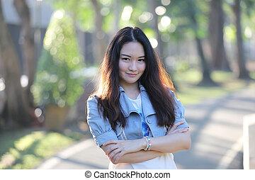 Portrait asian woman with our door park nature background