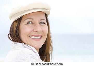 Portrait attractive happy senior woman outdoor isolated