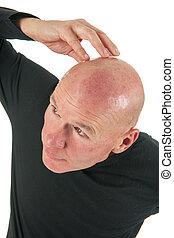 Portrait bald man