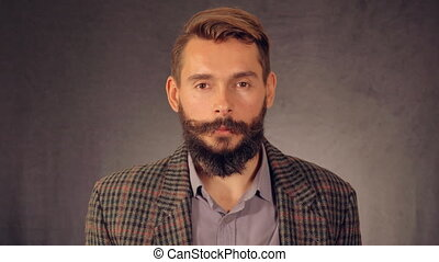 portrait bearded hipster shows sign win