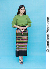 Portrait beautiful Asian girl in traditional Thai dress isolated on blue sky background. Cotton Dress