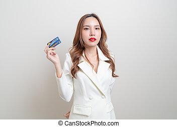 portrait beautiful Asian woman holding credit card