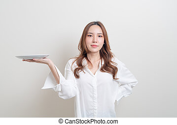 portrait beautiful Asian woman holding empty plate